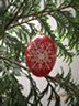 Hanging Christmas ornament pysanky on babasbeeswax.com
