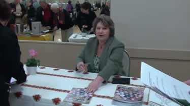Joan Brander at book signing About the Pysanka It Is Written!